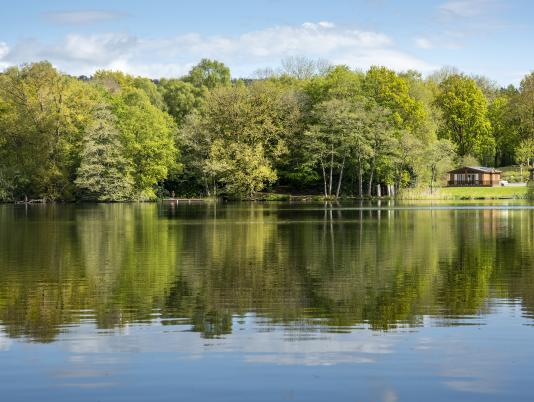 Lodge reflections across Pearl Lake