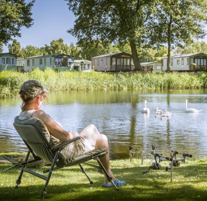 Caravan holiday park with fishing and swans 5 star
